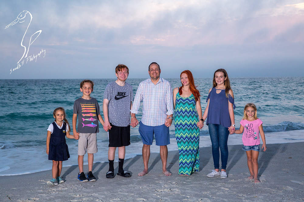 Anna Maria Island Engagement Session Holmes Beach Sunset flash Photography sand ocean Family holding hands  Engagement