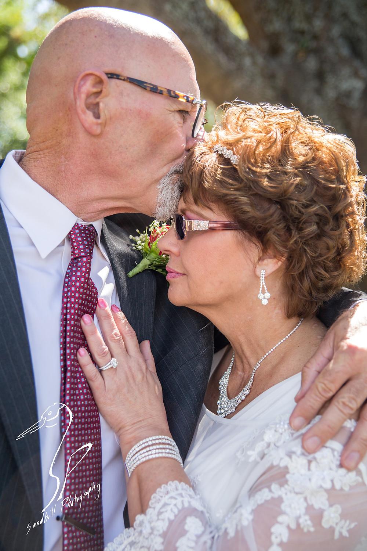 Anna Maria Oyster Bar Wedding Photography Bride Groom  kiss