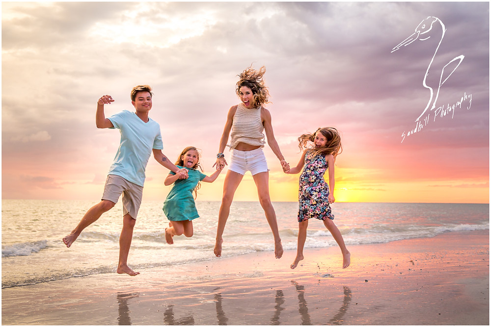 Bradenton Family Photographer | Top 10 tips for Pictures with Kids, family jumps on the beach at sunset