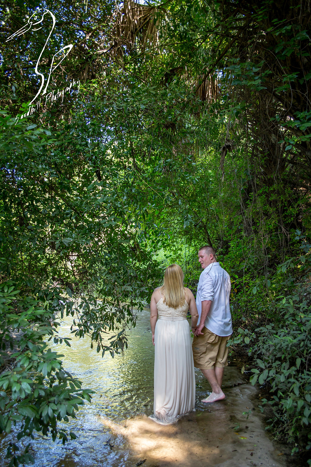 Rye Preserve Engagement Photography, couple walking through a creek in the woods, Sandhill Photography