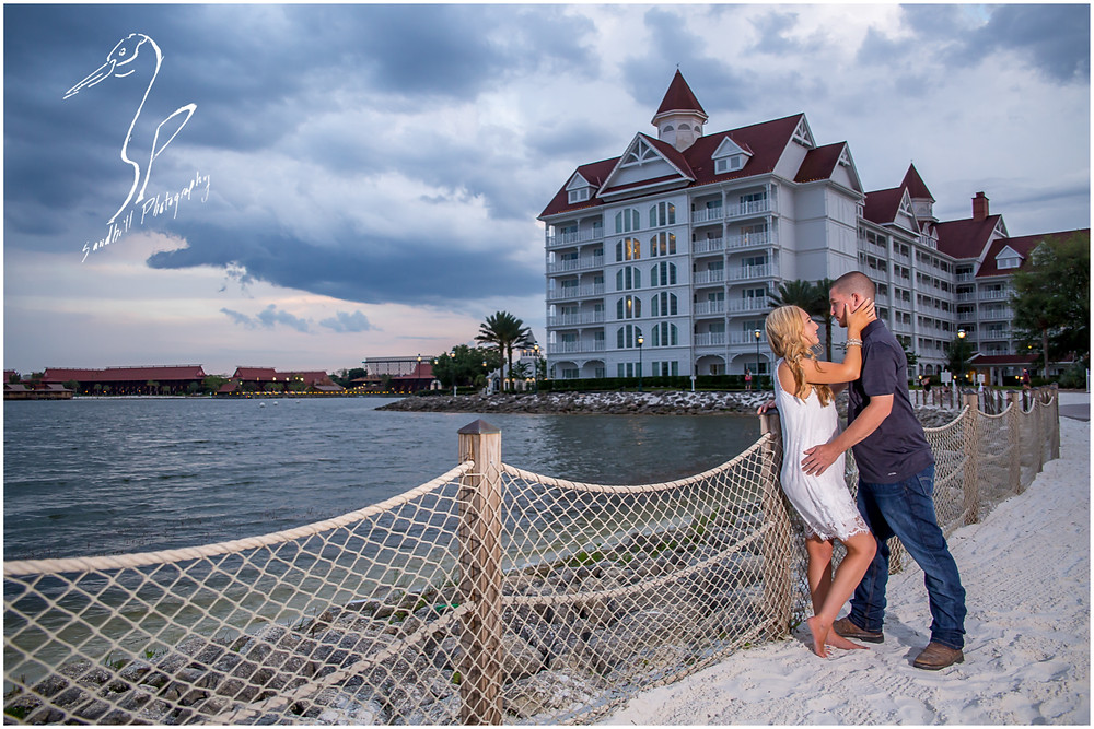 Disney's Grand Floridian Engagement Session, romantic portrait of engaged couple, hotel in background