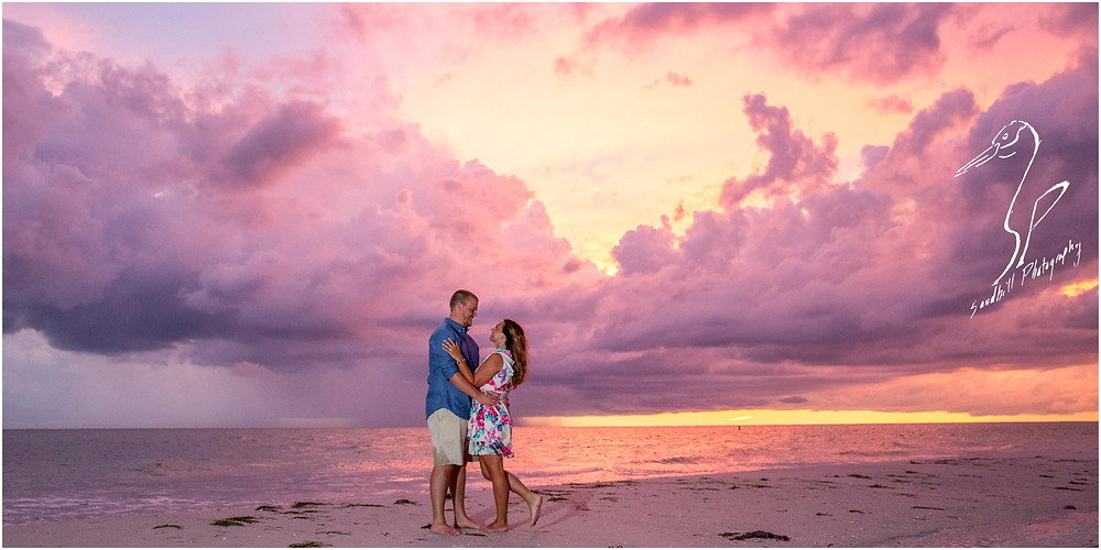 Bradenton Beach Engagement Photography, couple on the beach at sunset with purple clouds and natural light