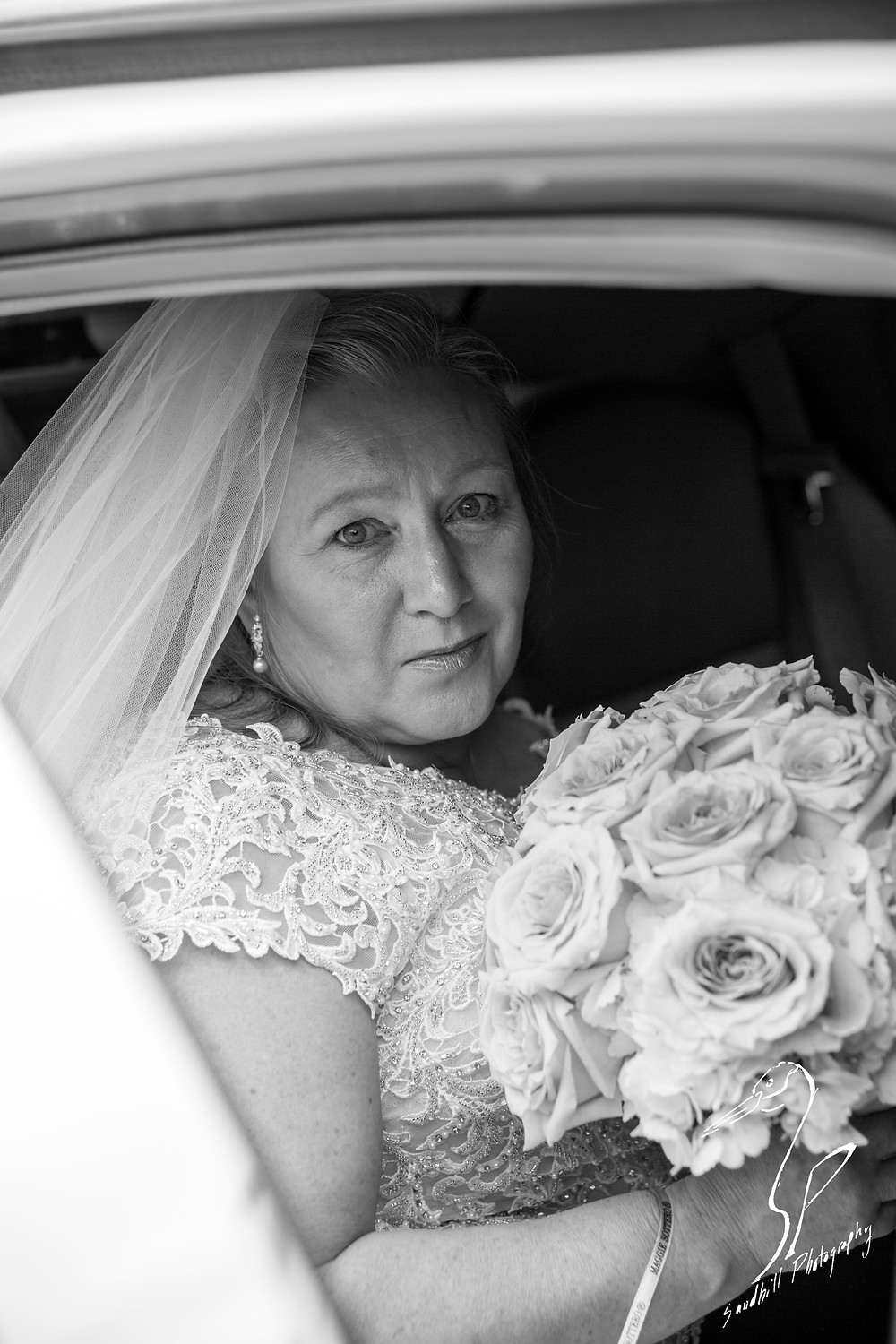 Rainy Day Wedding Photography Sarasota, Bride in the limo on her way to the church, black and white, Sandhill Photography
