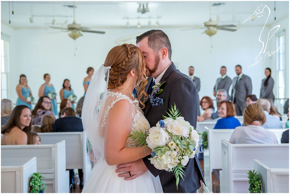 Sarasota Wedding Photography Crocker Memorial Church couple kissing in church after ceremony Sandhill Photography
