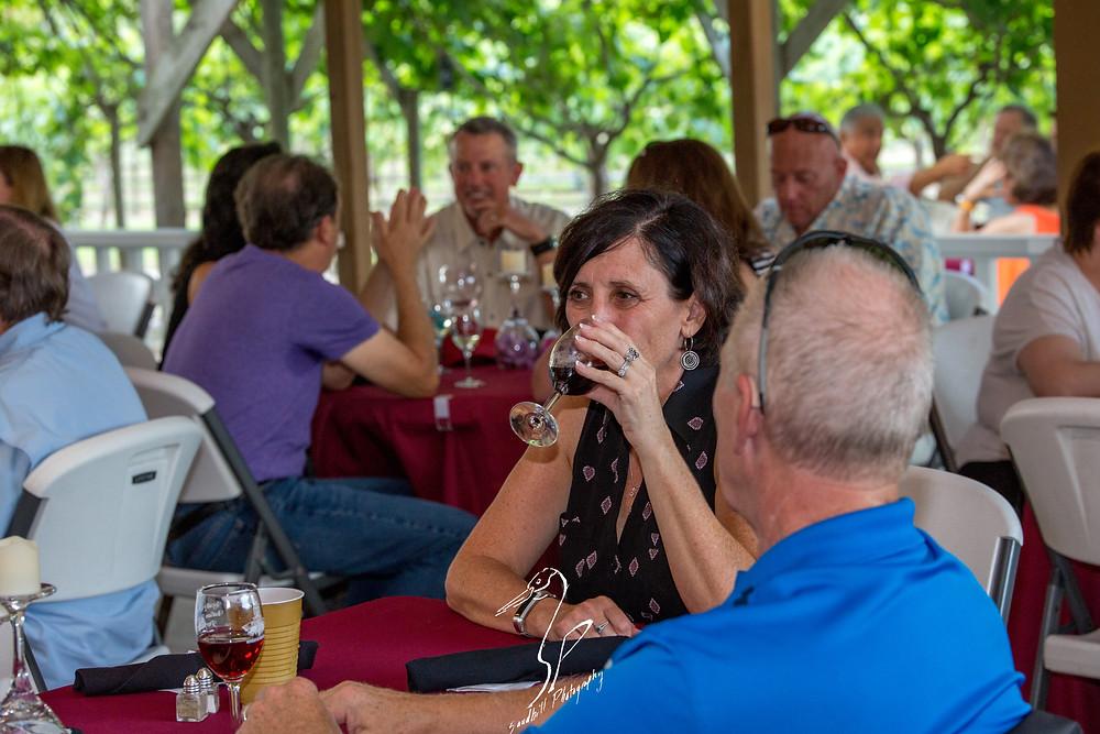 Fiorelli Winery & Vineyard wine 'n dine Bradenton guest drinking red wine pavilion