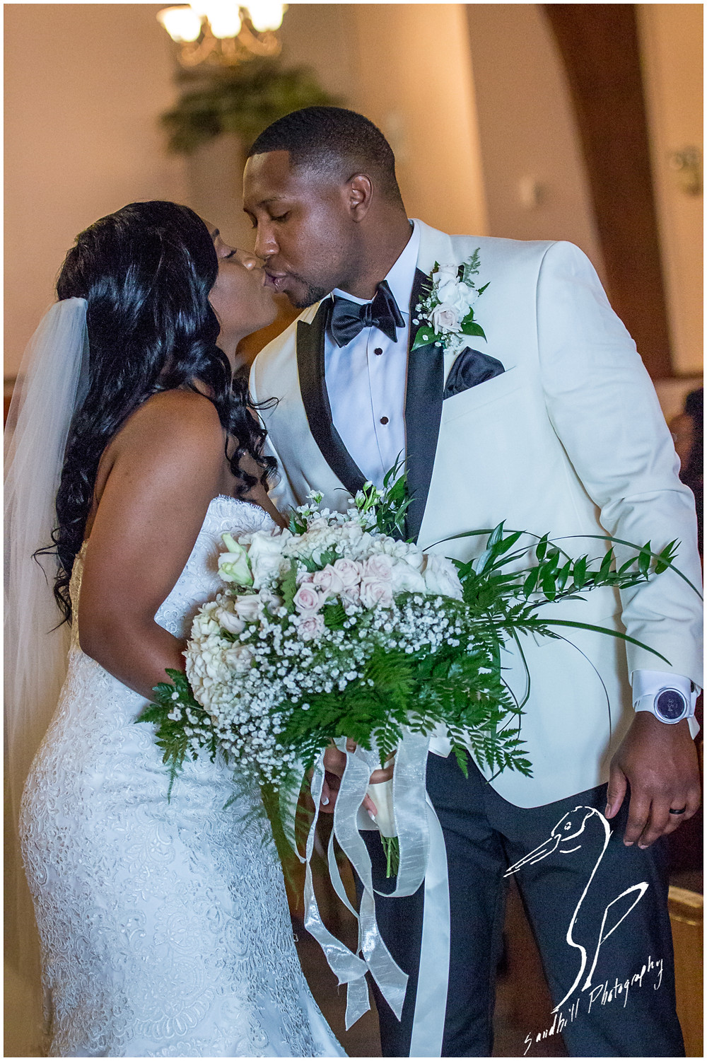 Bradenton Wedding Photographer, the bride and groom share their first kiss at United First Methodist Church of Seffner