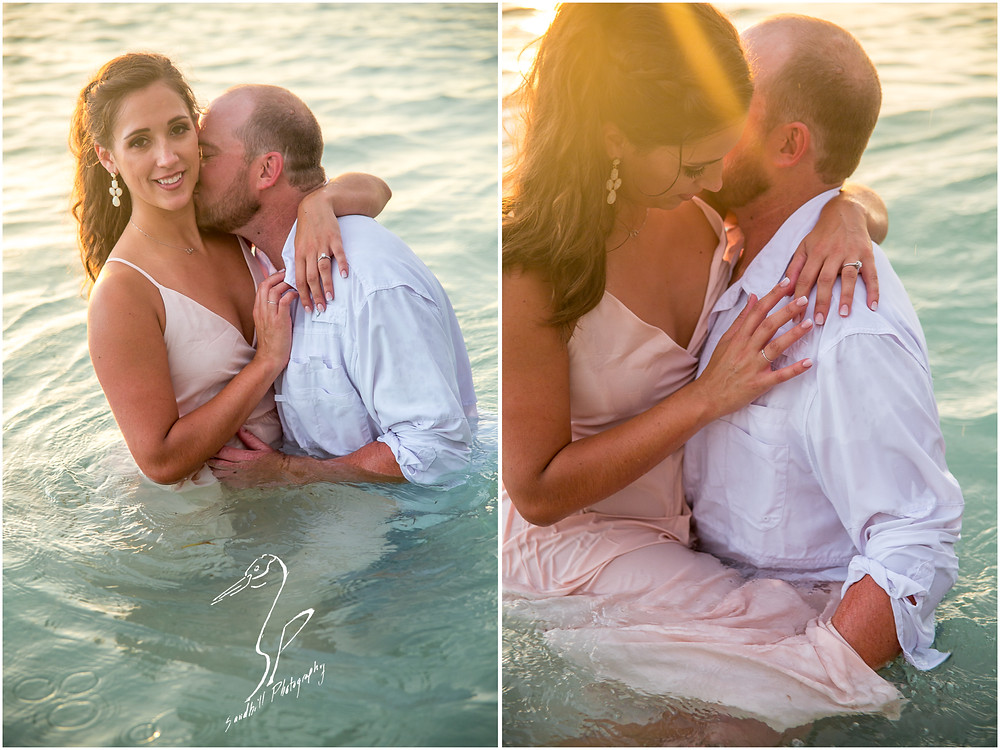 Beer Can Island Engagement Photography, an engaged couple embrace romantically in the water with the sun setting behind them