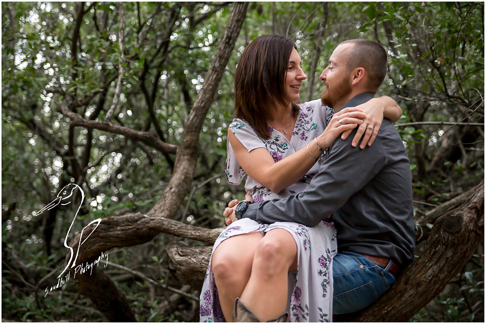 Bradenton Engagement Photographer, woman wraps her arms around her fiance during their Engagement Session with Sandhill Photography