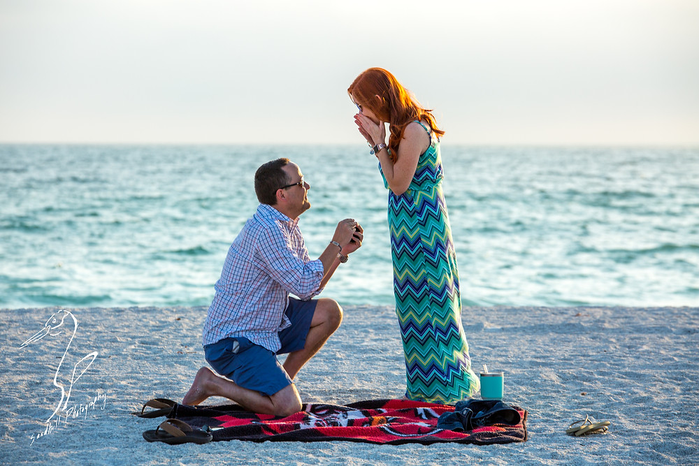 Anna Maria Island Engagement Session Holmes Beach Sunset Photography Engagement proposal surprise sand ocean chevron dress on one knee