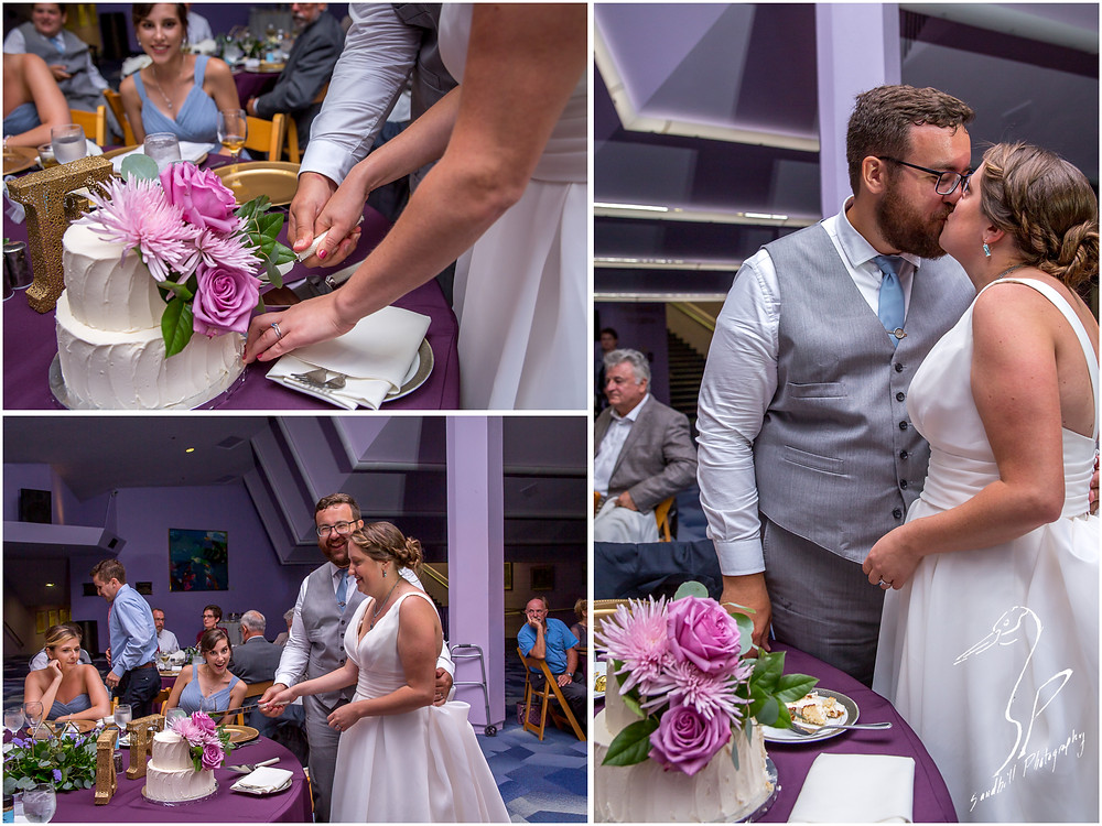 Van Wezel Wedding Photography, the bride and groom cut their cake and share a kiss in the Grand Foyer reception