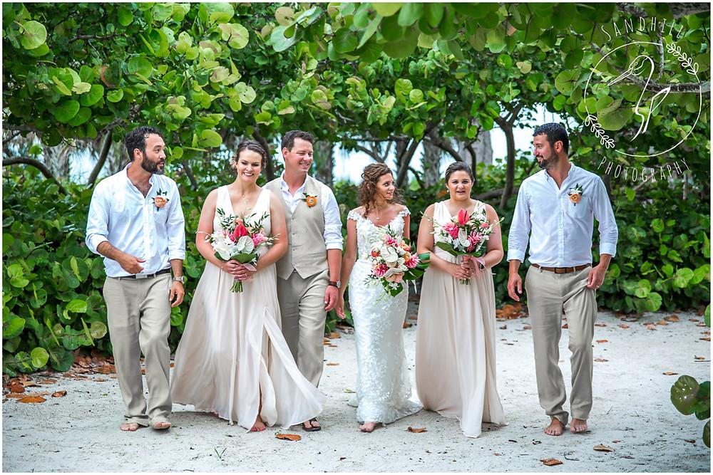 Anna Maria Island Wedding Photographer Wedding Party walking at The Sandbar Restaurant