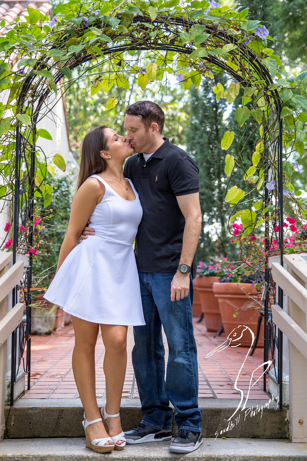 Engagement Photography Selby Gardens archway flowers kiss Sandhill Photography