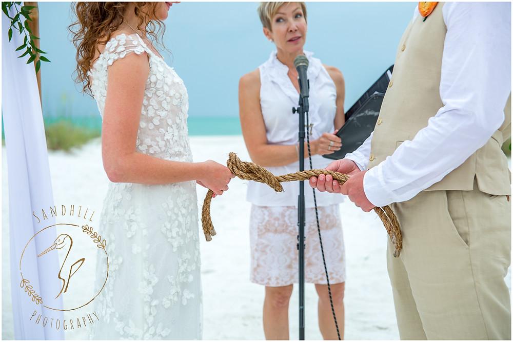 Anna Maria Island Wedding Photographer couple tying-the-knot beach ceremony