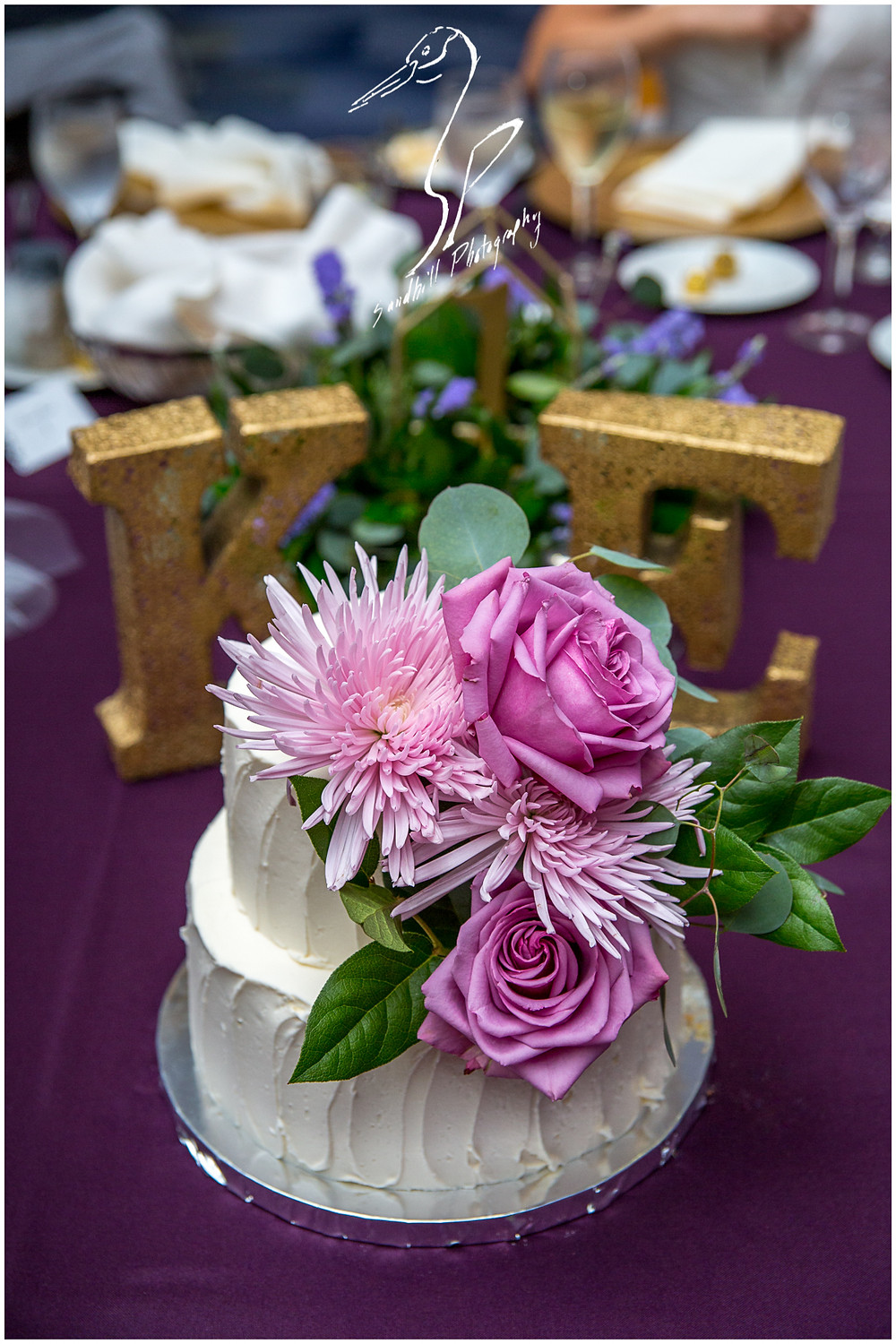 Van Wezel Wedding Photography, detail picture of cake by Mattison's, white cake with purple flowers, Sandhill Photography, Sarasota