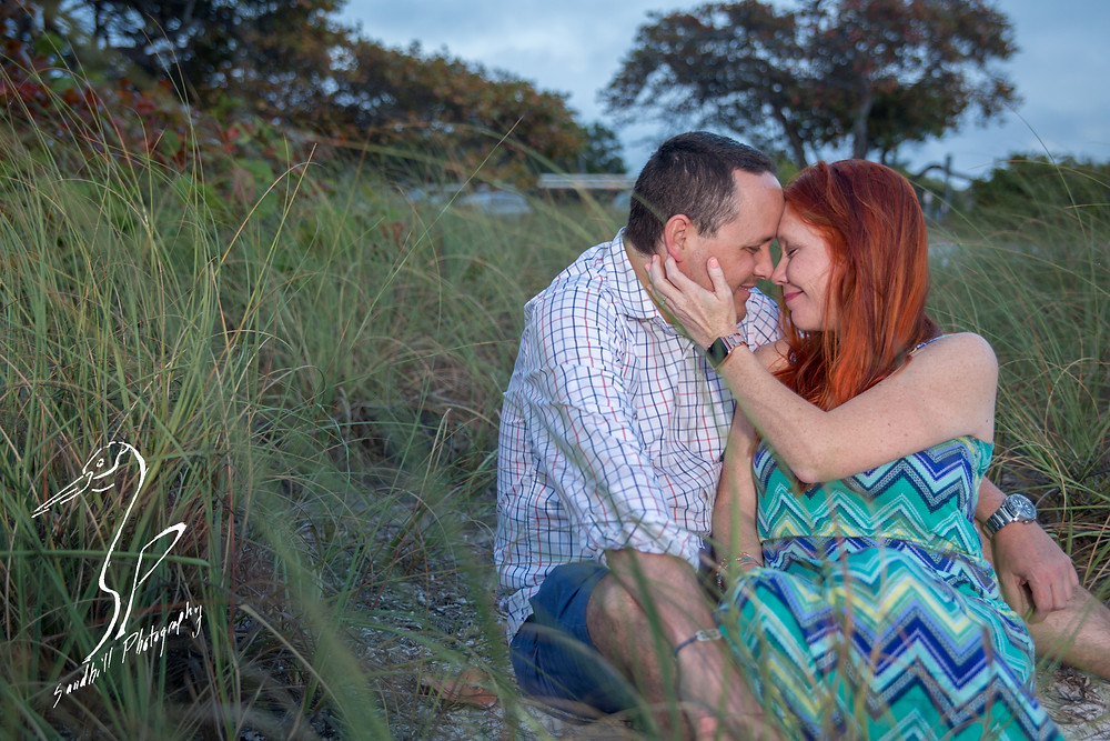 Anna Maria Island Engagement Session Holmes Beach Sunset Photography Flash sea grass hand on cheek couple Engagement chevron dress