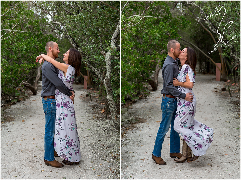 Bradenton Engagement Photographer, engaged couple embraces on a path through the woods at De Soto National Memorial