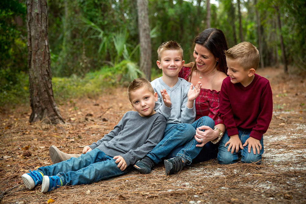 Bradenton Family Photographer | Top 10 tips for Pictures with Kids, boys sit with their mom in the woods