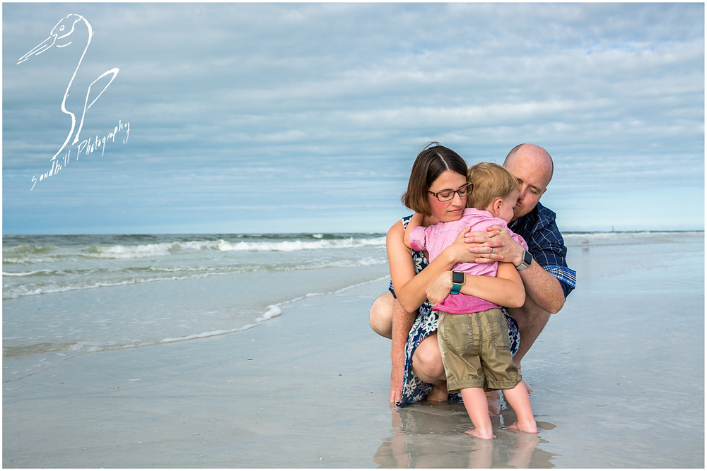 Bradenton Family Photographer | Top 10 tips for Pictures with Kids, family shares a hug on the beach Sandhill Photography