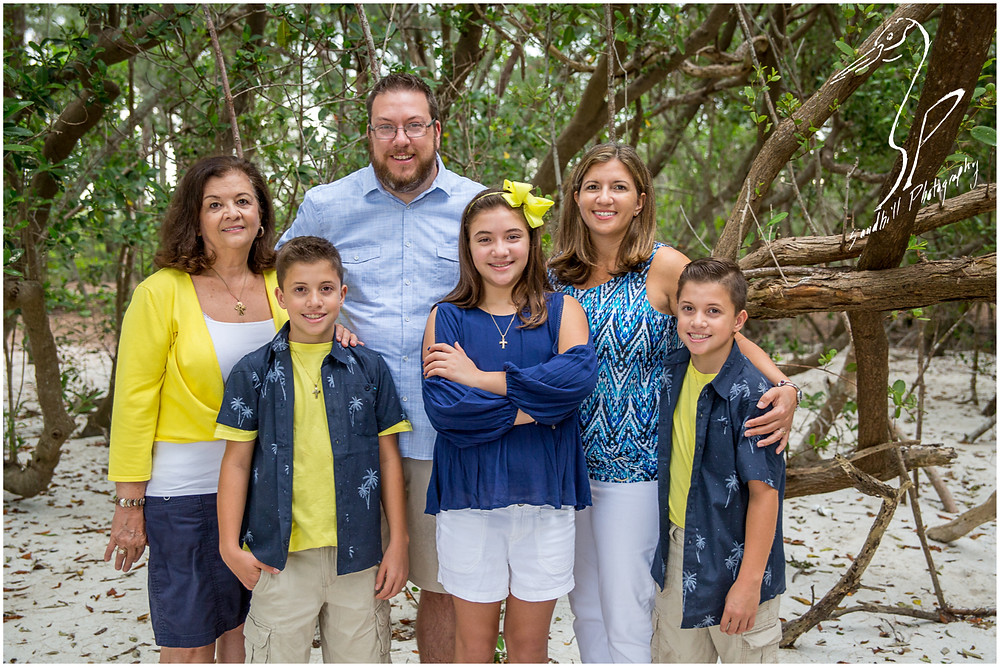 Longboat Key Family Photographer, the entire family stops to pose for a picture in the woods at the beach