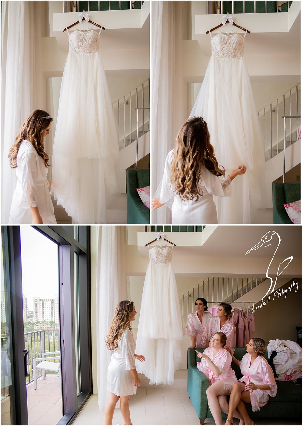 Sarasota Beach Wedding Photography, Bride getting ready to put on her dress at Hyatt Regency Sarasota