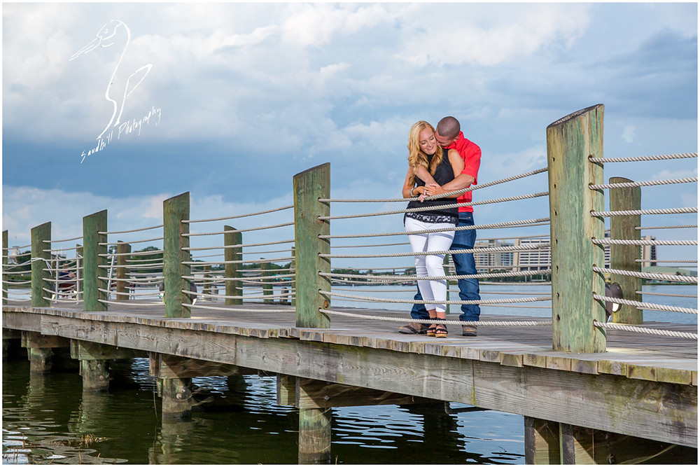 Disney's Grand Floridian Engagement Session, photography of coupe embracing on a dock.
