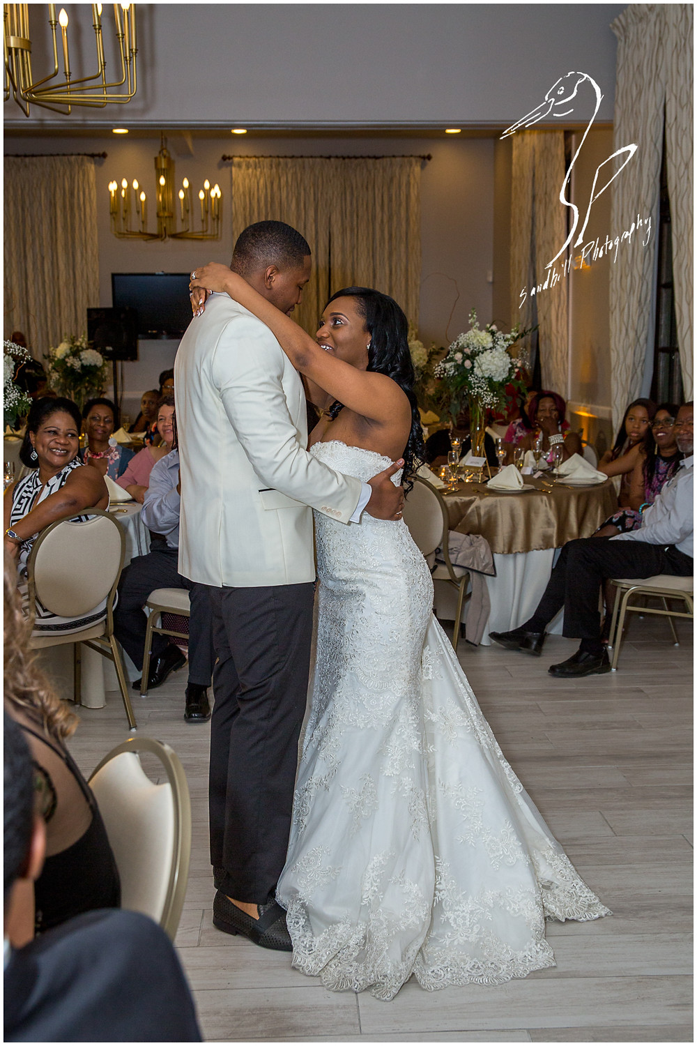 Bradenton Wedding Photographer, The bride and groom share their first dance at their reception at the Mirabay Club