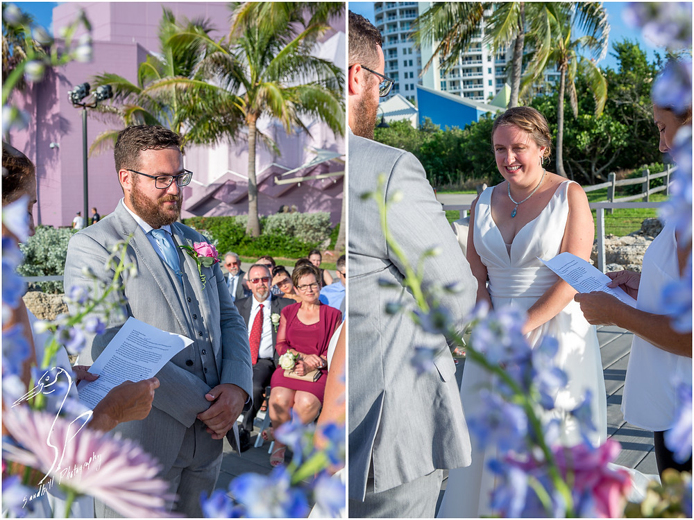 Van Wezel Wedding Photography, the bride and are viewed through the flowers as they look at each other during the ceremony, Sarasota Florida
