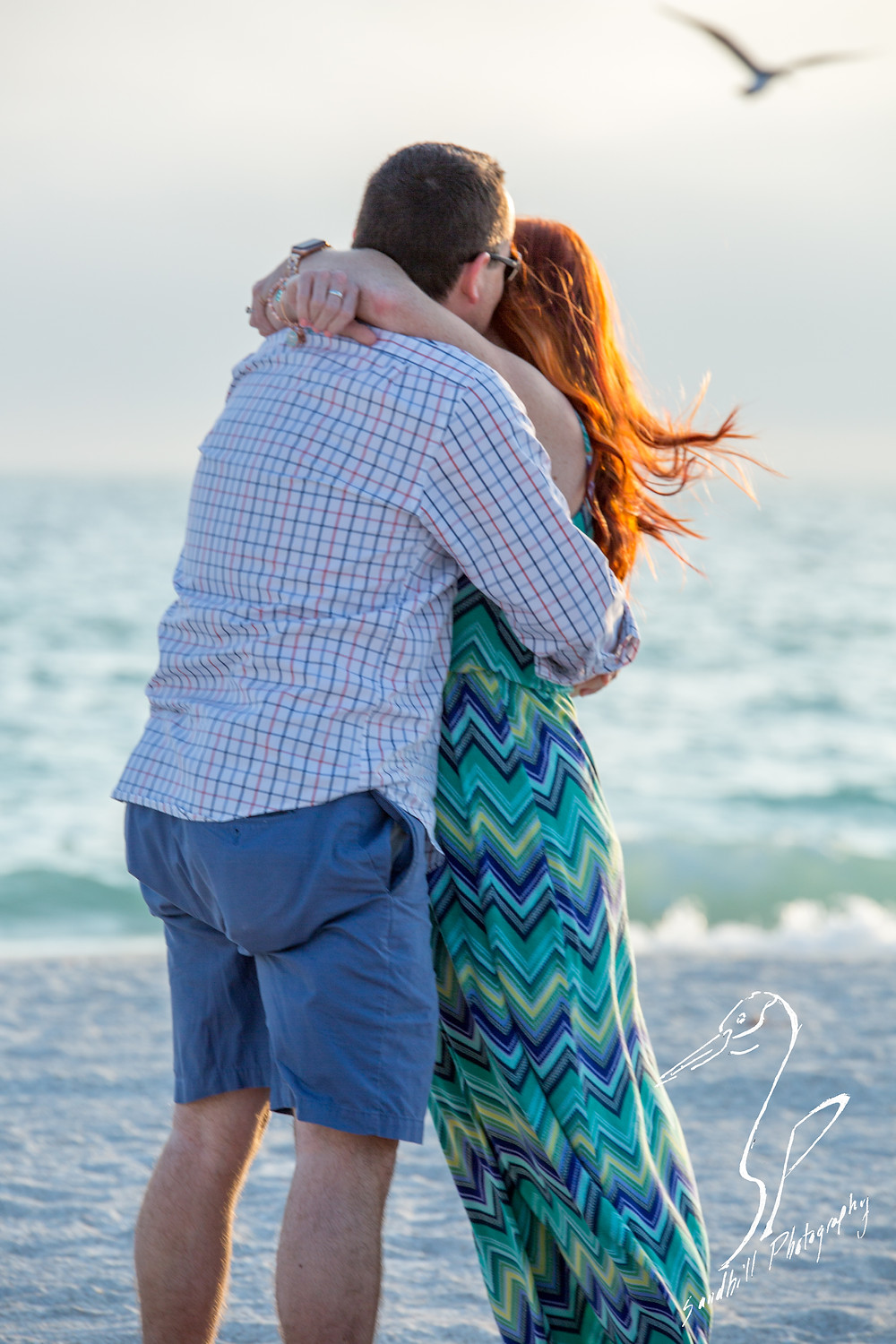 Anna Maria Island Engagement Session Holmes Beach Sunset flash Photography Engagement proposal sand ocean bird hug chevron dress