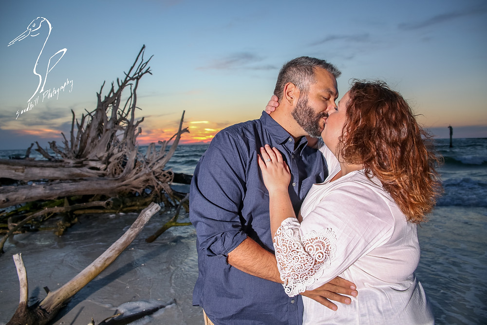Beer Can Island Sunset Engagement Photography couple kiss drift wood dead trees sand beach ocean romantic flash