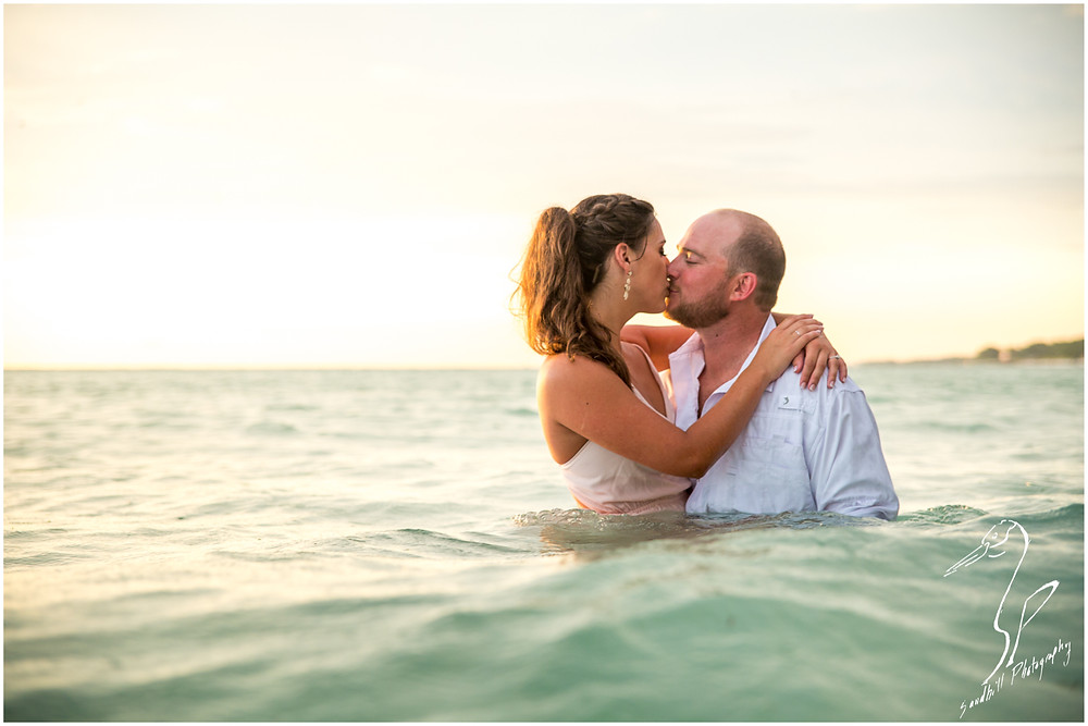 Beer Can Island Engagement Photography couple kissing in the water on Longboat Key