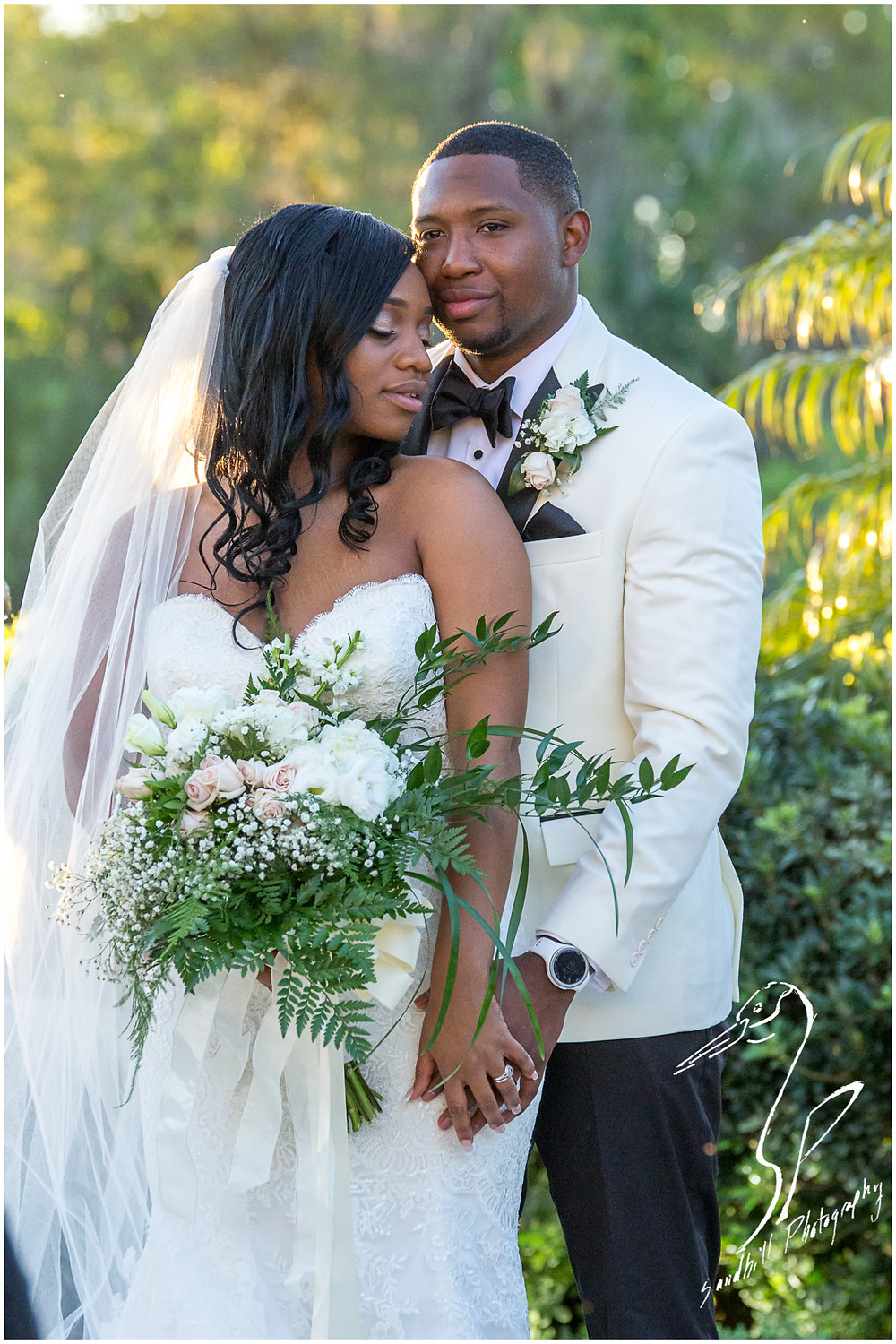 Bradenton Wedding Photographer, Portrait of the bride and groom intimately embracing in a garden at the Mirabay Club