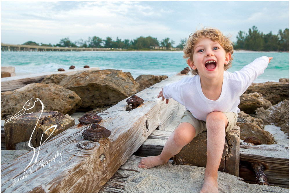 Bradenton Family Photographer | Top 10 tips for Pictures with Kids, child laughs on a beach jetty by Sandhill Photography