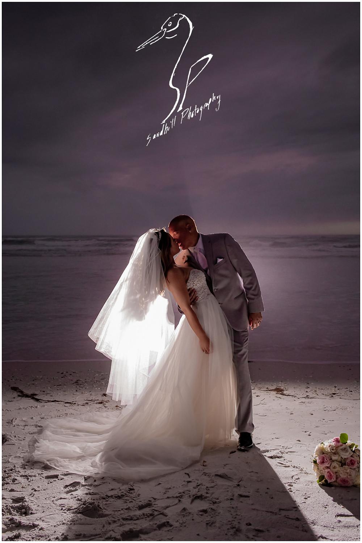 Sarasota Beach Wedding Photography, dramatic back lit wedding portrait on Lido Key Beach by Sandhill Photography