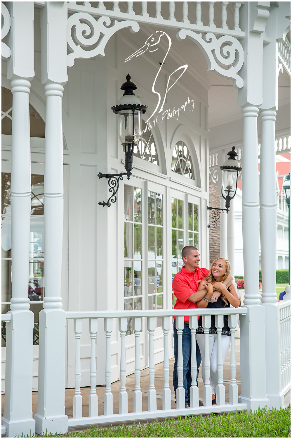 Disney's Grand Floridian Engagement Session, happy couple embrace on the resort terrace