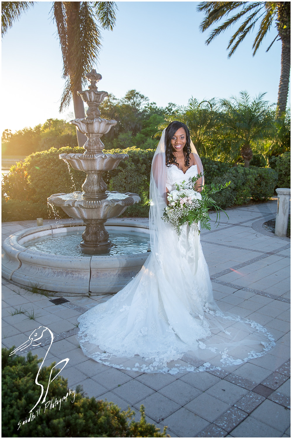 Bradenton Wedding Photographer, Portrait of the bride in front of a fountain at the Mirabay Club