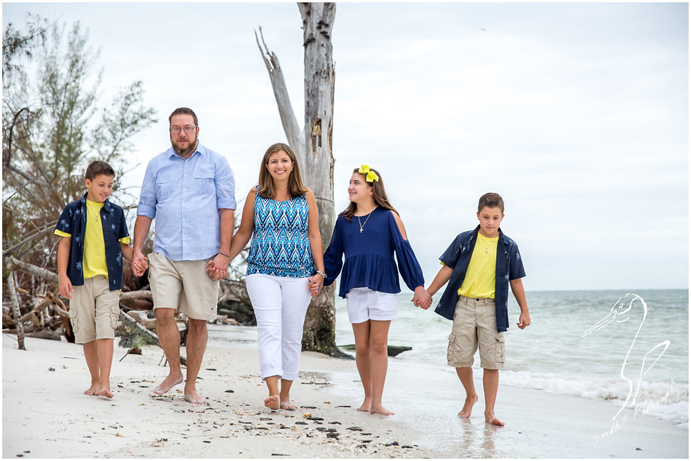 Longboat Key Family Photographer, family walking on the beach holding hands Sandhill Photography