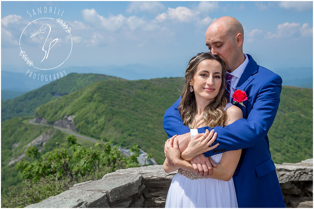 Destination Wedding Photographer, newlyweds embrace on mountain top, image by Sandhill Photography, Bradenton FL