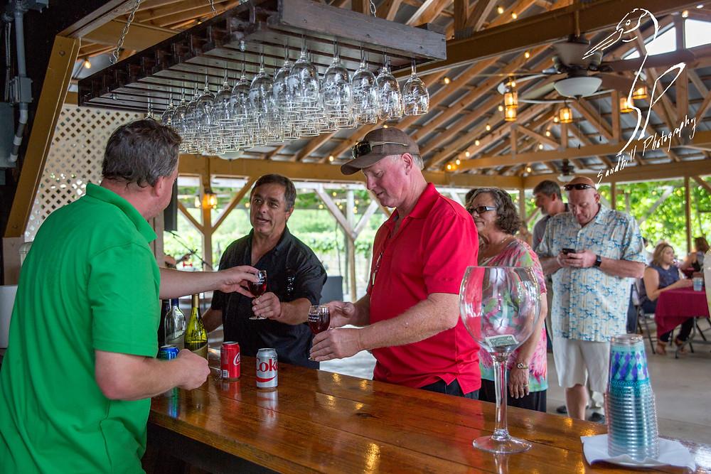Fiorelli Winery & Vineyard wine 'n dine Bradenton bartender red wine hanging wine glasses pavilion