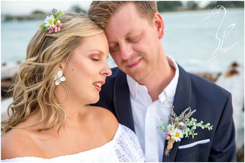 Anna Maria Island Wedding Photography, couple nestled together at Coquina Beach for a wedding portrait