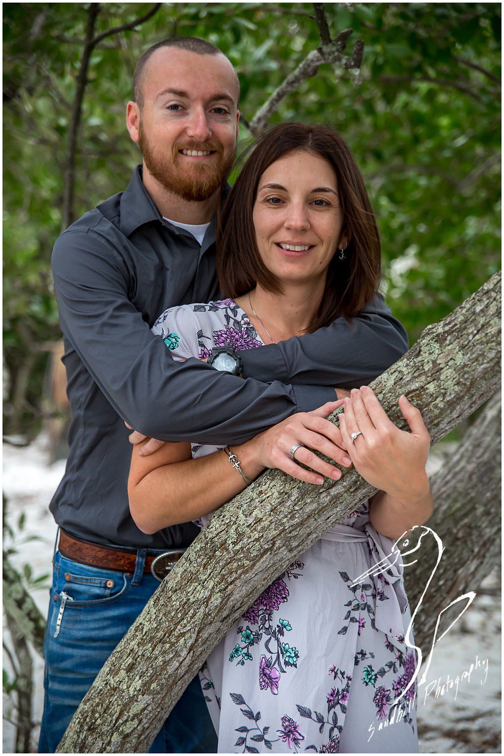 Bradenton Engagement Photographer, engaged couple embrace in the trees at De Soto National Memorial