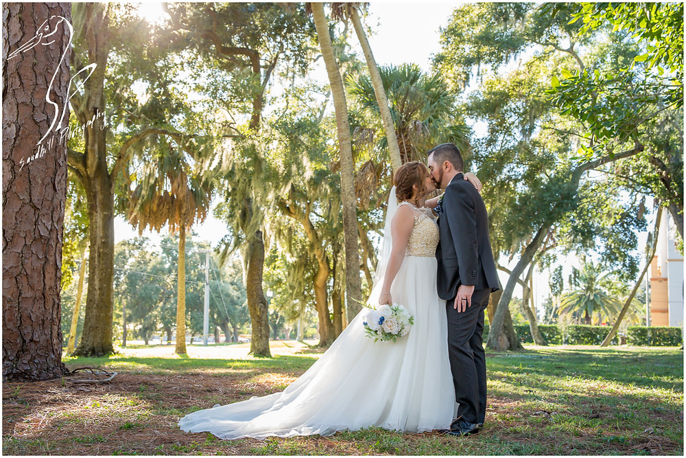 Sarasota Wedding Photography Crocker Memorial Church the bride and groom share a kiss in the sunlight captured by Sandhill Photography