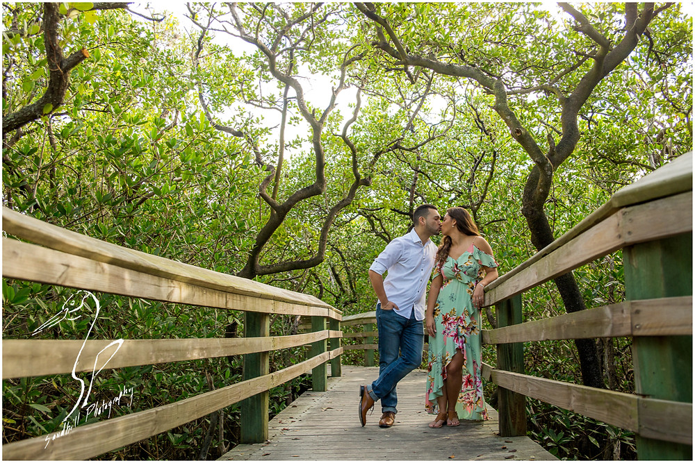 DeSoto National Memorial Photography, a couple share a kiss on the boardwalk under the mangroves, Bradenton FL