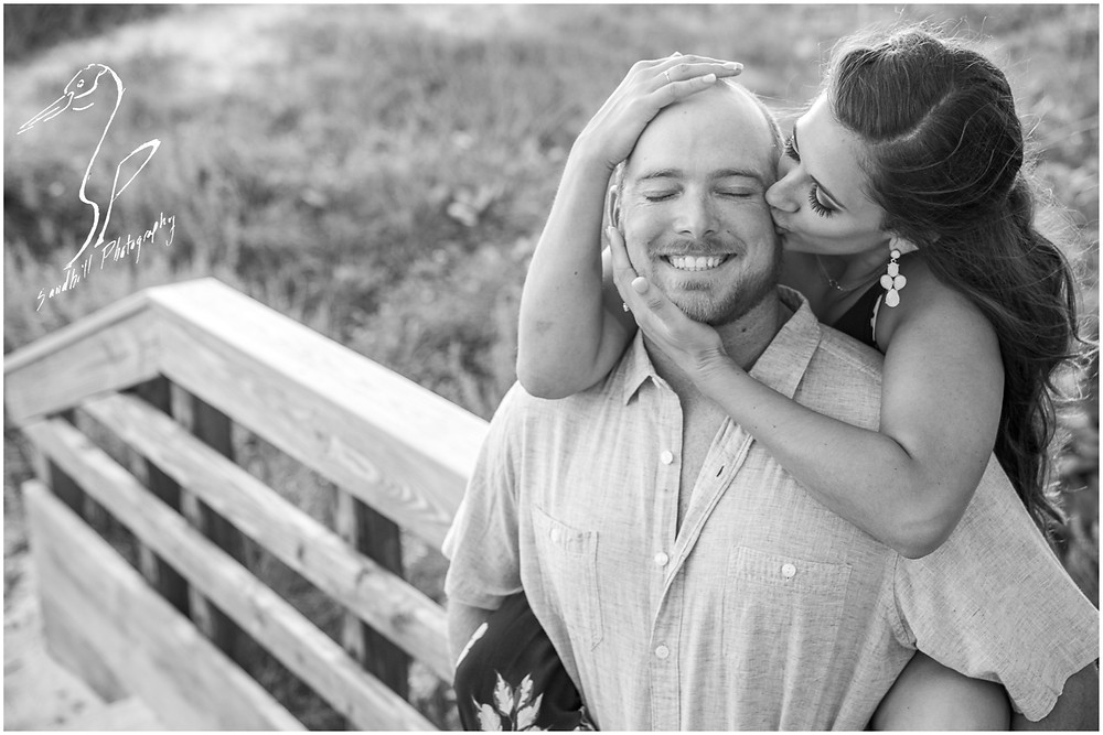 Beer Can Island Engagement Photography, black and white image of and engaged couple where she is kissing his cheek
