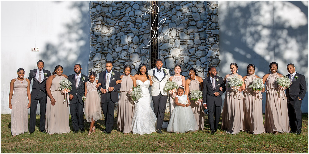 Bradenton Wedding Photographer, Wedding party portrait with the entire bridal party walking in front of United First Methodist Church of Seffner