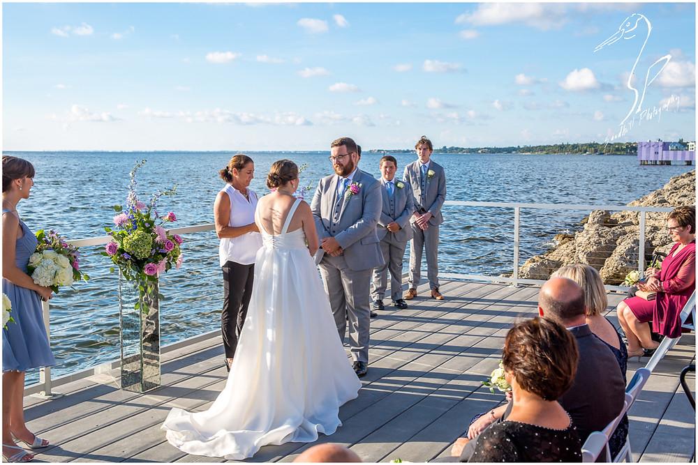 Van Wezel Wedding Photography, Wedding ceremony overlooking Sarasota Bay, by Sandhill Photography