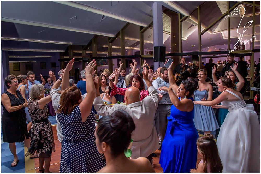 Van Wezel Wedding Photography, guests enjoy the dance floor at the Grand Foyer reception