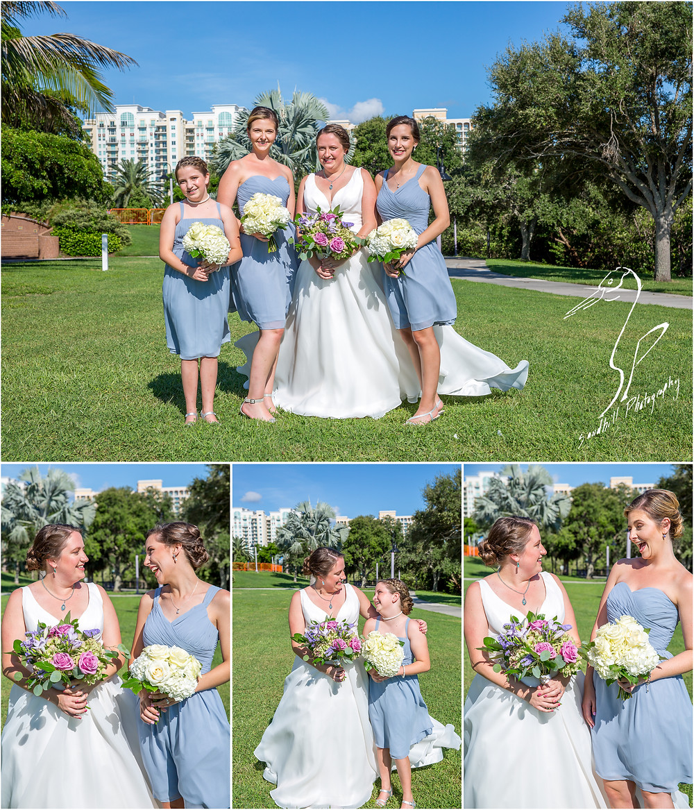 Van Wezel Wedding Photography, Bride and Bridesmaids in light blue in front of Down Town Sarasota