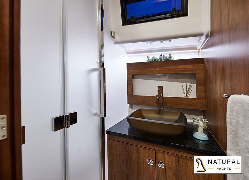 Northman 1200 Flybridge Motor Yachtbathroom with toilet, sink, and shower