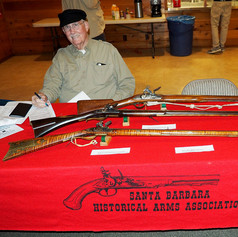 Lee Draughon with a British Brown Bess Flintlock Musket .75 caliber, 18th Century Flintlock Long Rifle .50 caliber and an early 19th Century American Long Rifle Flintlock .45 caliber.