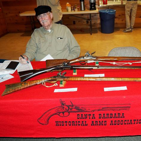 Lee Draughon with a British Brown Bess Flintlock Musket .75 caliber, 18th Century Flintlock Long Rifle .50 caliber and an early 19th Century American Long Rifle Flintlock .45 caliber.